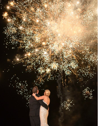 couple kissing under fireworks